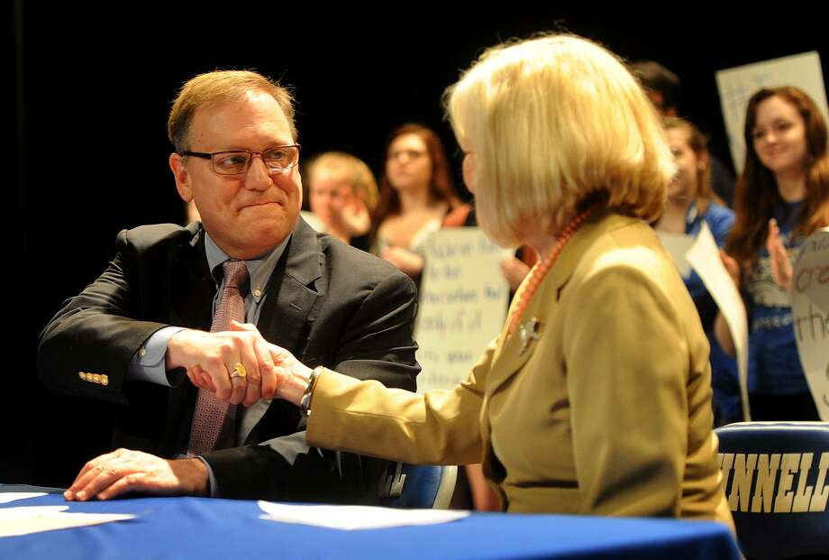 Stratford Mayor John Harkins shakes hand with Superintendent of Schools Janet Robinson after vetoing the Town Council's 2017-18 budget at Bunnell High School in Stratford, Conn. on Thursday, May 25, 2017. Harkins criticized the budget which would caused cuts to the education system in town. Photo: Brian A. Pounds / Hearst Connecticut Media / Connecticut Post