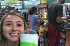 On Wednesday when Kaycee James sauntered into a San Antonio Valero Corner Store for a giant ICEE. She posed for a photo with her icy drink before noticing the big man in the background.