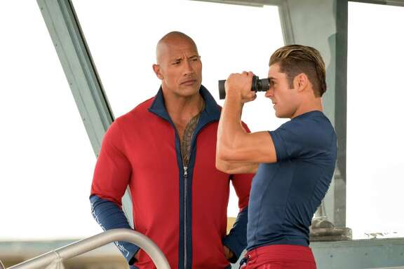 "Dwayne Johnson and Zac Efron in ""Baywatch."" (Frank Masi/Paramount Pictures)"
