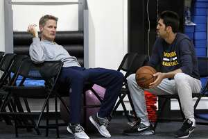 Warriors head coach Steve Kerr talks with General Manager Bob Myers during practice at the Warriors headquarters in Oakland, Calif., on Thursday, May 25, 2017.