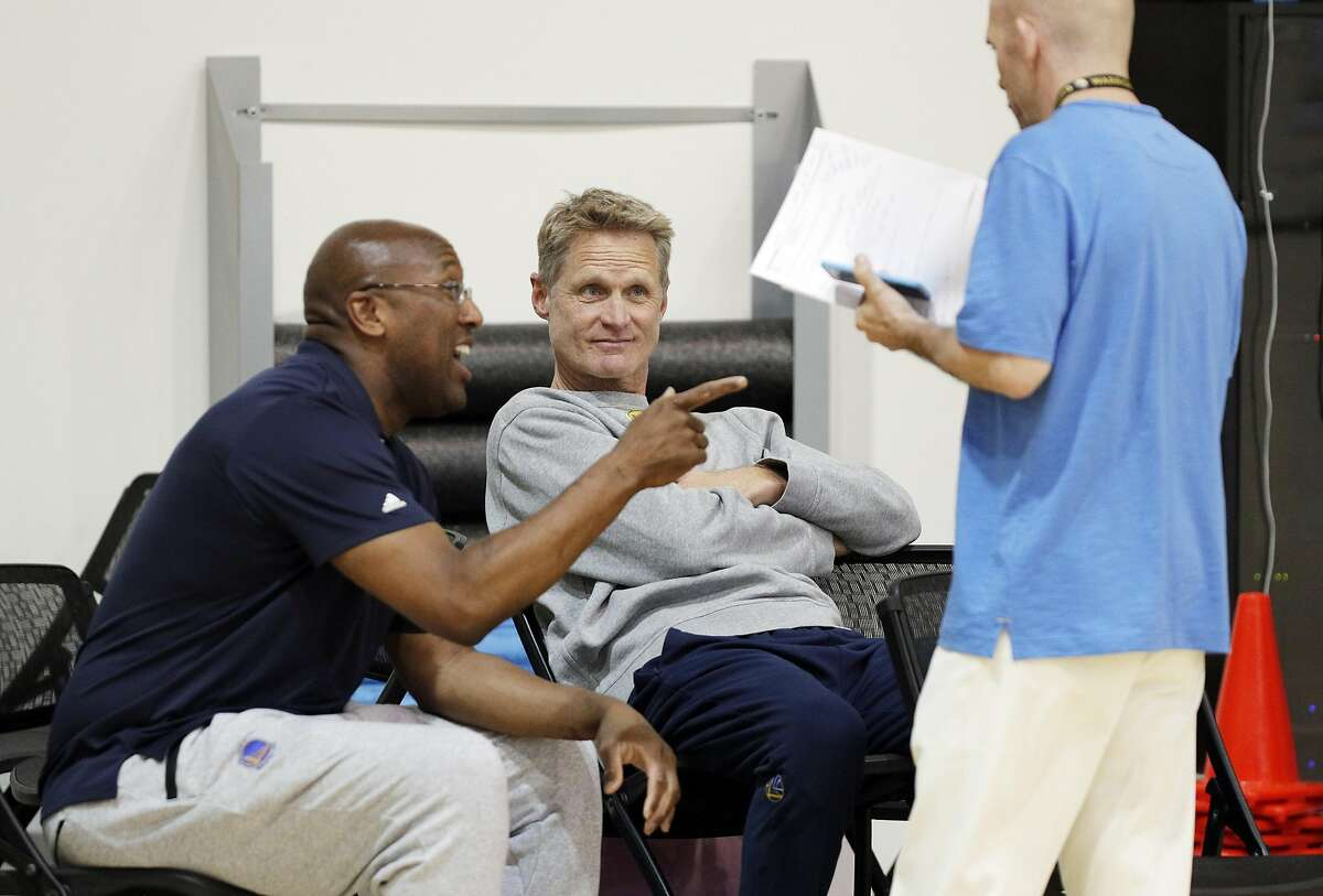 Warriors head coach Steve Kerr talks with acting head coach Mike Brown and Raymond Ridder during practice at the Warriors headquarters in Oakland, Calif., on Thursday, May 25, 2017.