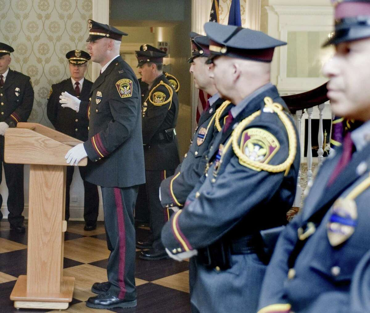 Ridgefield Police Captain Jeffrey Kreitz speaks at the department's annual Memorial Ceremony at The Lounsbury House in Ridgefield to honor and pay tribute to the deceased members of the department. For a listing of Memorial Day events in the Danbury area, see page A3