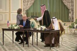 A reader says President Donald Trump looked regal sitting next to King Salman during a ceremony at the Royal Court Palace in Riyadh, Saudi Arabia.
