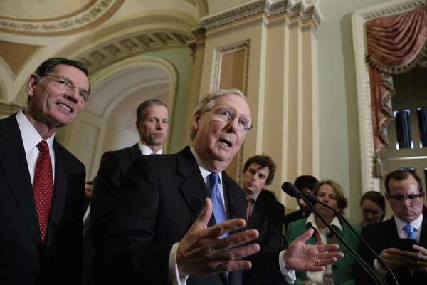 Senate Majority Leader Mitch McConnell, joined by Sen. John Barrasso, R-Wy. (left), and Sen. John Thune, R-S.D., speak to reporters about the pending GOP health care bill in March. The Senate should not get credit for passing only a marginally less destructive bill than the House's. But that appears to be what's afoot.