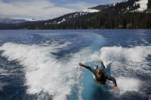 Jeff Stoike, 31, surfs a wake on Lake Tahoe May 24, 2017 in Lake Tahoe, Calif. Stoike is a captain and instructor with High Sierra Water Ski School. Because of the vast amounts of snow, Stoike is able to surf in the morning on the lake and go snowboarding at Squaw Valley in the afternoon if he desires.