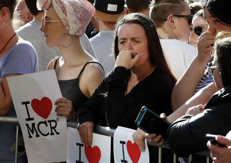 People attend a vigil in Albert Square, Manchester, England, Tuesday, the day after the suicide attack at an Ariana Grande concert that left 22 people dead as it ended on Monday night. Photo: Kirsty Wigglesworth /Associated Press / Copyright 2017 The Associated Press. All rights reserved.