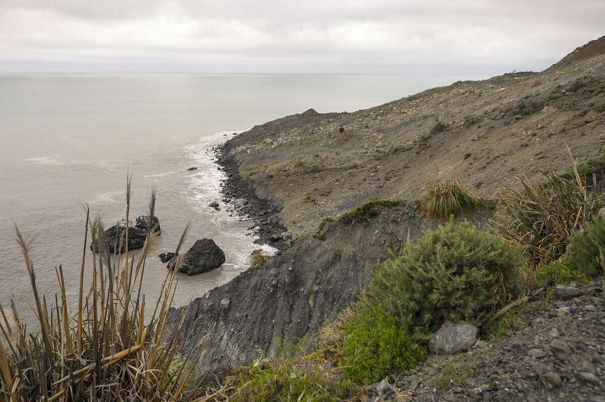 Waves crash on the shore on Wednesday, May 24, 2017, after a massive landslide that went into the Pacific Ocean over the weekend in Big Sur, Calif. The slide buried a portion of Highway 1 under a 40-foot layer of rock and dirt and changed the coastline below to include what now looks like a rounded skirt hem, Susana Cruz, a spokeswoman with the California Department of Transportation, said Tuesday. (Joe Johnston/The Tribune (of San Luis Obispo) via AP)