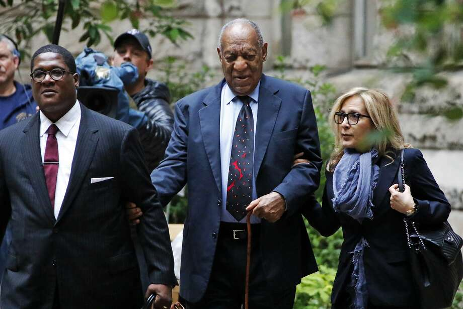 Bill Cosby (center) arrives at the courthouse in Pittsburgh last May during his first assault trial. Photo: Gene J. Puskar, AP