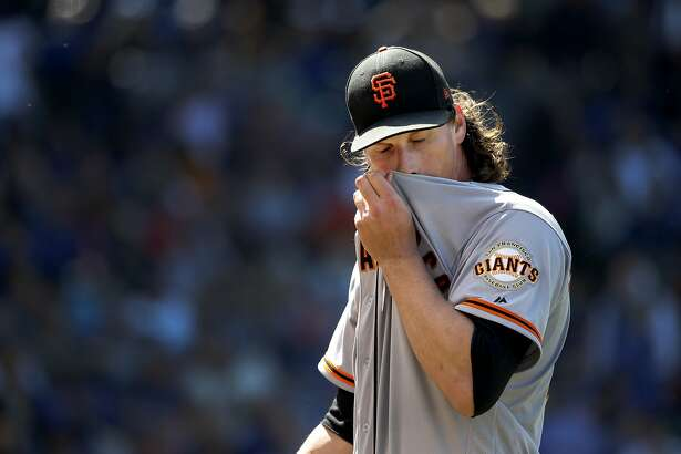 San Francisco Giants starting pitcher Jeff Samardzija wipes the sweat from his face after the seventh inning of a baseball game against the Chicago Cubs Thursday, May 25, 2017, in Chicago. (AP Photo/Charles Rex Arbogast)