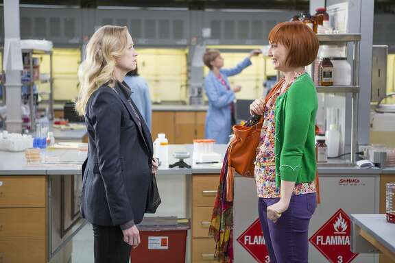 "Insensitive lab researcher Serena (Anna Lise Phillips, left) gets an attitude readjustment from the perky Caroline (Jill E. Alexander) in the comedy ""Sensitivity Training."""