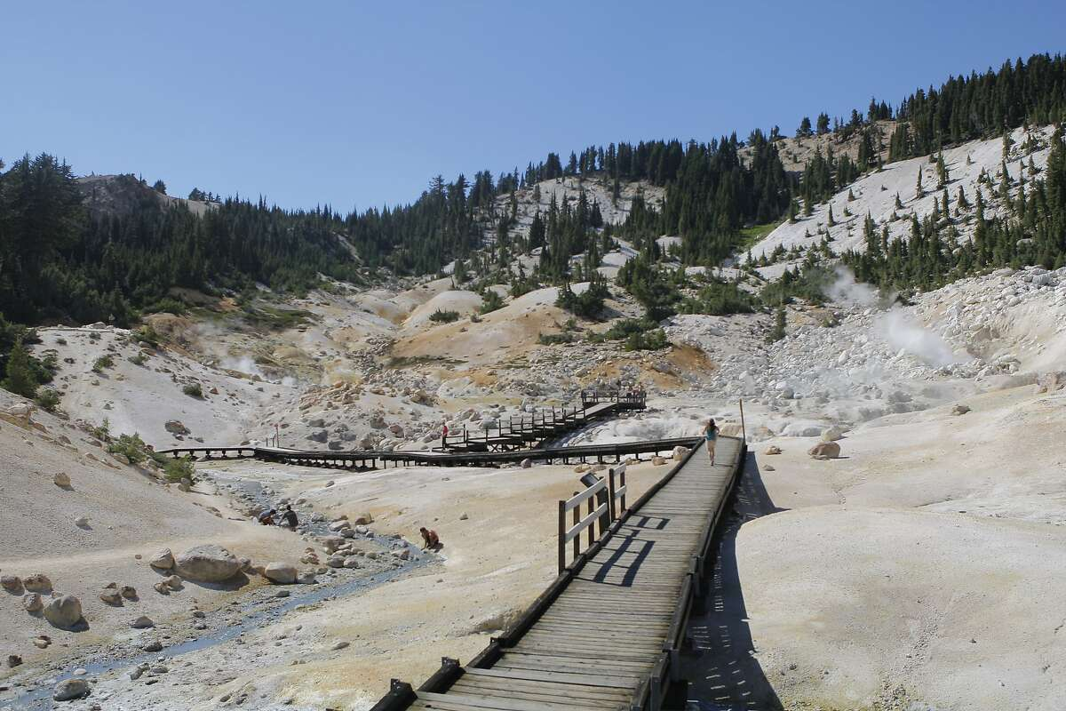 At Bumpass Hell geothermal area at Lassen Volcanic National Park, walkways provide a tour past boiling mud pots and steam vents~~