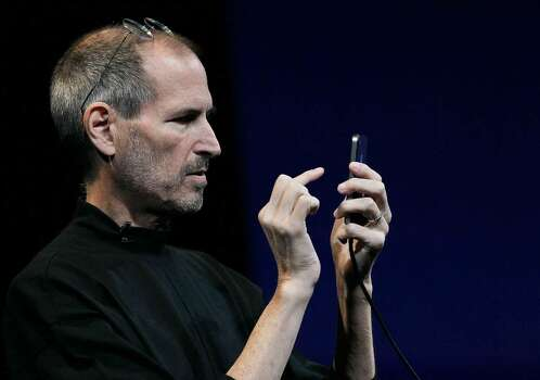 SAN FRANCISCO - JUNE 07:  Apple CEO Steve Jobs demonstrates the new iPhone 4 as he delivers the opening keynote address at the 2010 Apple World Wide Developers conference June 7, 2010 in San Francisco, California. Jobs kicked off their annual WWDC with the announcement of the new iPhone 4.  (Photo by Justin Sullivan/Getty Images) *** Local Caption *** Steve Jobs Photo: Justin Sullivan, Getty Images / 2010 Getty Images