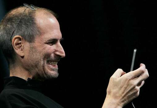 SAN FRANCISCO - JUNE 07:  Apple CEO Steve Jobs demonstrates the new iPhone 4 as he delivers the opening keynote address at the 2010 Apple World Wide Developers conference June 7, 2010 in San Francisco, California. Jobs kicked off their annual WWDC with the announcement of the new iPhone 4  (Photo by Justin Sullivan/Getty Images) *** Local Caption *** Steve Jobs Photo: Justin Sullivan, Getty Images / 2010 Getty Images