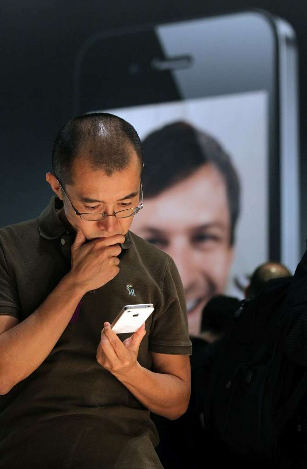 SAN FRANCISCO - JUNE 07: A member of the media inspects the new iPhone 4 at the 2010 Apple World Wide Developers conference June 7, 2010 in San Francisco, California. Apple CEO Steve Jobs kicked off their annual WWDC with the announcement of the new iPhone 4. (Photo by Justin Sullivan/Getty Images)