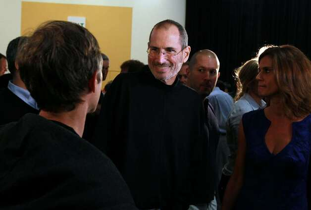 SAN FRANCISCO - JUNE 07:  Apple CEO Steve Jobs holds greets an attendee after he delivered the opening keynote address at the 2010 Apple World Wide Developers conference June 7, 2010 in San Francisco, California. Jobs kicked off their annual WWDC with the announcement of the new iPhone 4.  (Photo by Justin Sullivan/Getty Images) *** Local Caption *** Steve Jobs Photo: Justin Sullivan, Getty Images / 2010 Getty Images