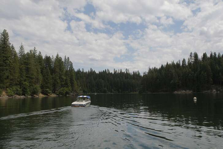Drought buster: plenty of water at near-full Lake Britton at McArthur-Burney Falls State Park . . . boat heads out from marina, where rentals are available for boats, kayaks, canoes and pedal boats
