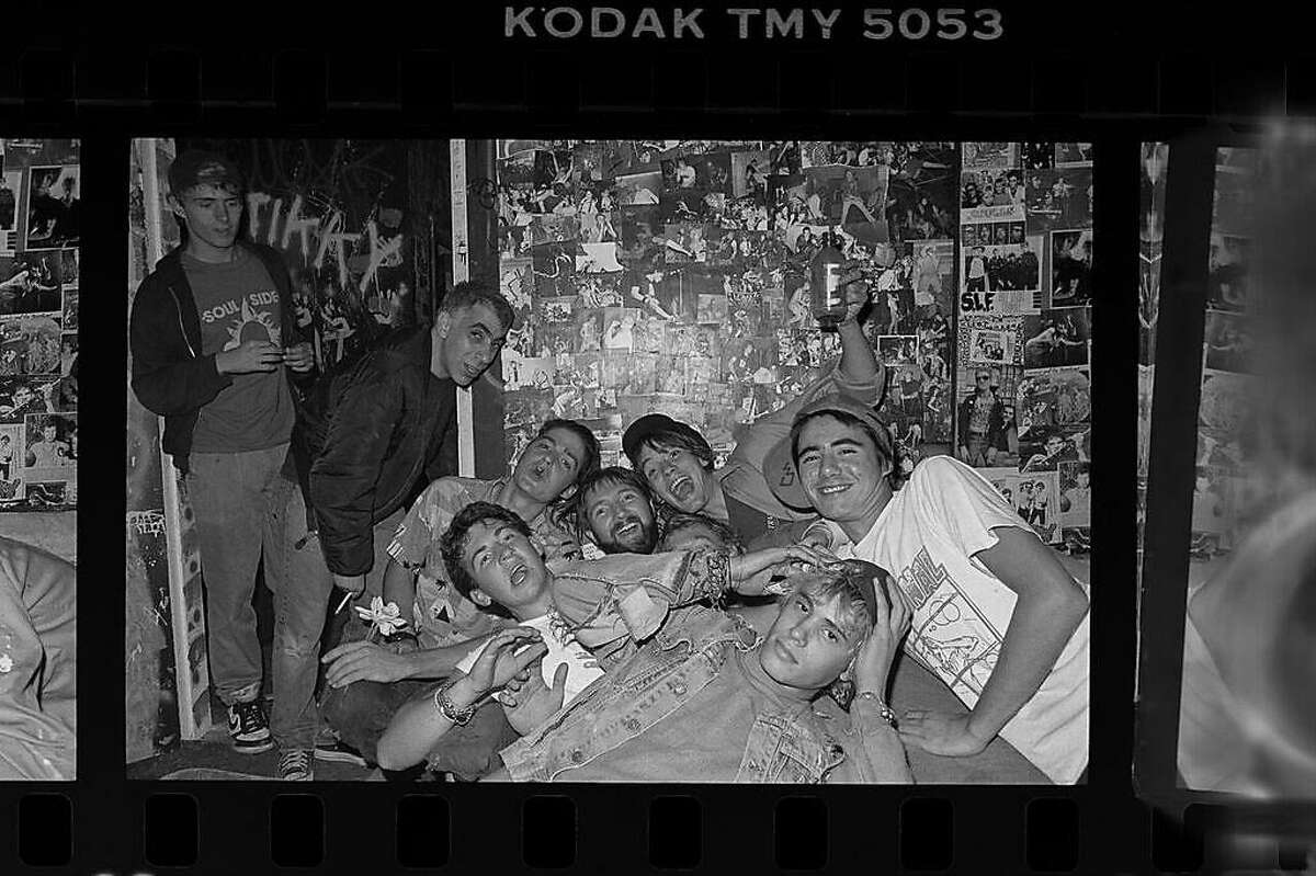 FILE - Volunteers were key to keeping 924 Gilman afloat. A group poses at the club in the 1980s. 924 Gilman plans to put up a memorial wall of Bowles' photography, as well as stories about him.