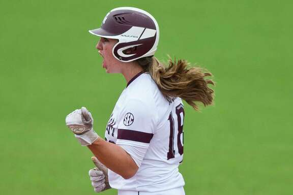 Texas A&M outfielder Sarah Hudek (18) celebrates after hitting a double off Texas State pitcher Randi Rupp (4) during a college softball game Saturday, May 20, 2017, in College Station, Texas. (Timothy Hurst/College Station Eagle via AP)