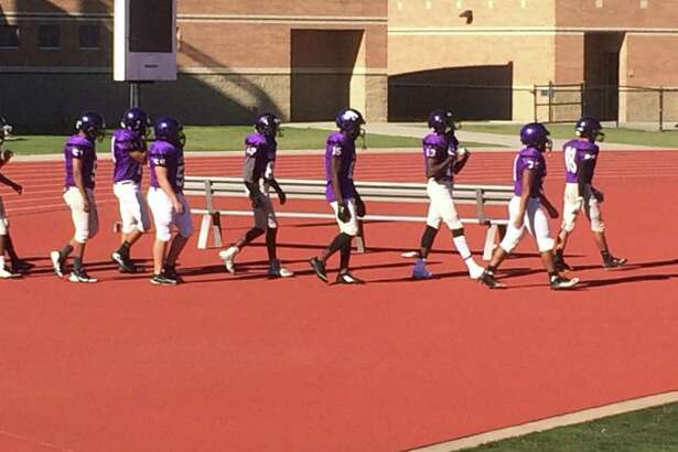 The purple team takes the field before the Humble Spring Football Game at Turner Field on May 24.