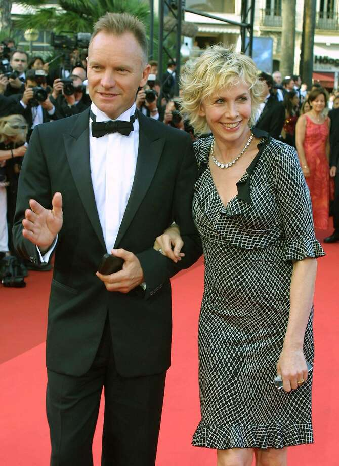 """British rock star Sting arrives with his wife Trudy Styler to attend the screening of the film """"All or Nothing """", directed by Briton Mike Leigh, which is in competition at the 55th International Film Festival in Cannes, in southeastern France, Friday, May 17, 2002. (AP Photo/Michel Euler) Photo: PATRICK GARDIN, AP"""