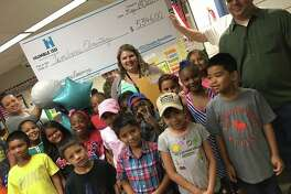 Humble ISD Education Foundation Bus Prize Posse spent Friday May 19 visiting different campuses and awarding grands.