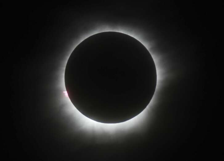 FILE - This March 9, 2016 file photo shows a total solar eclipse in Belitung, Indonesia. Hotel rooms already are going fast in Wyoming and other states along the path of next year�s solar eclipse. The total solar eclipse on Aug. 21, 2017, will be the first in the mainland U.S. in almost four decades.   (AP Photo, File)