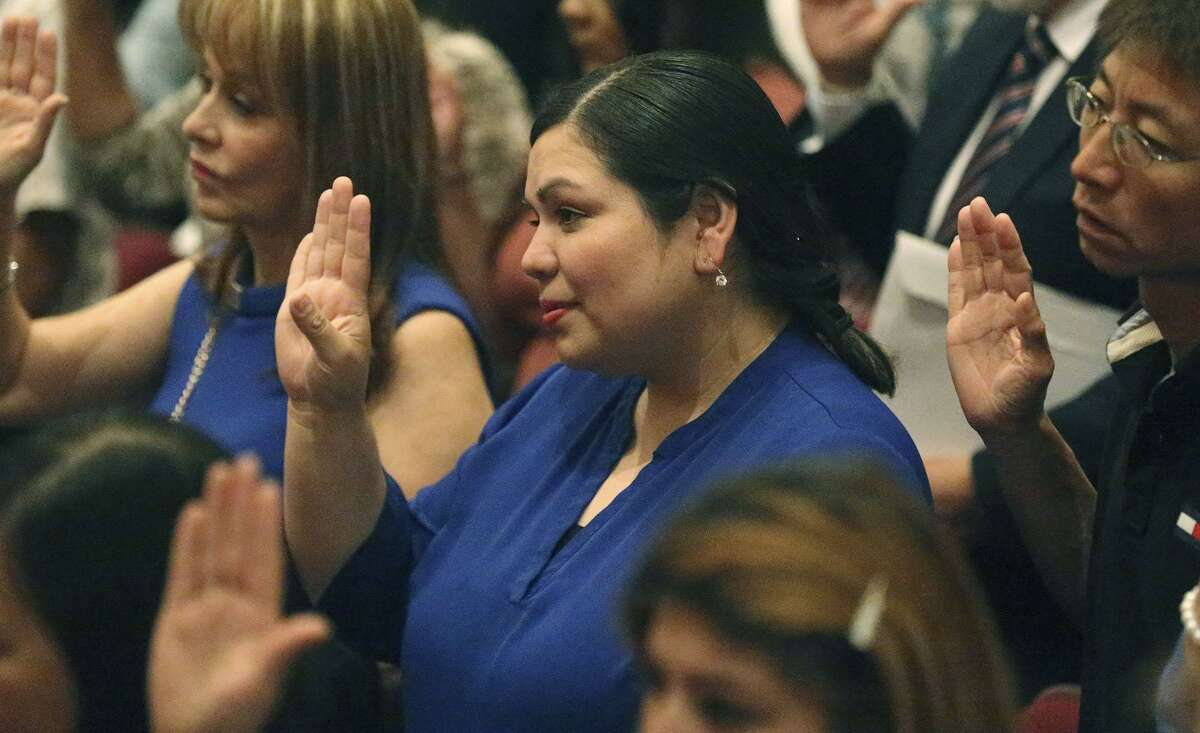 Benita Holguin (center), formerly Benita Veliz, became a naturalized U.S. citizen Thursday at the Edgewood ISD Theater for the Performing Arts. She garnered national attention in 2009 when she became the symbol of Dreamers who were brought to the United States when they were children.
