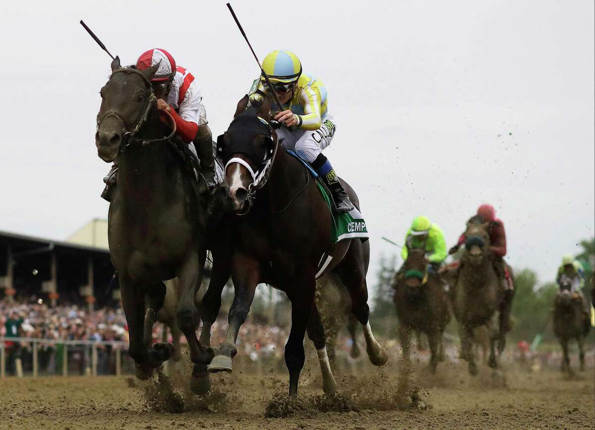 Cloud Computing (2), ridden by Javier Castellano, left, wins 142nd Preakness Stakes horse race at Pimlico race course as Classic Empire (5) with Julien Leparoux aboard takes second, Saturday, May 20, 2017, in Baltimore. (AP Photo/Matt Slocum) ORG XMIT: MDMS141