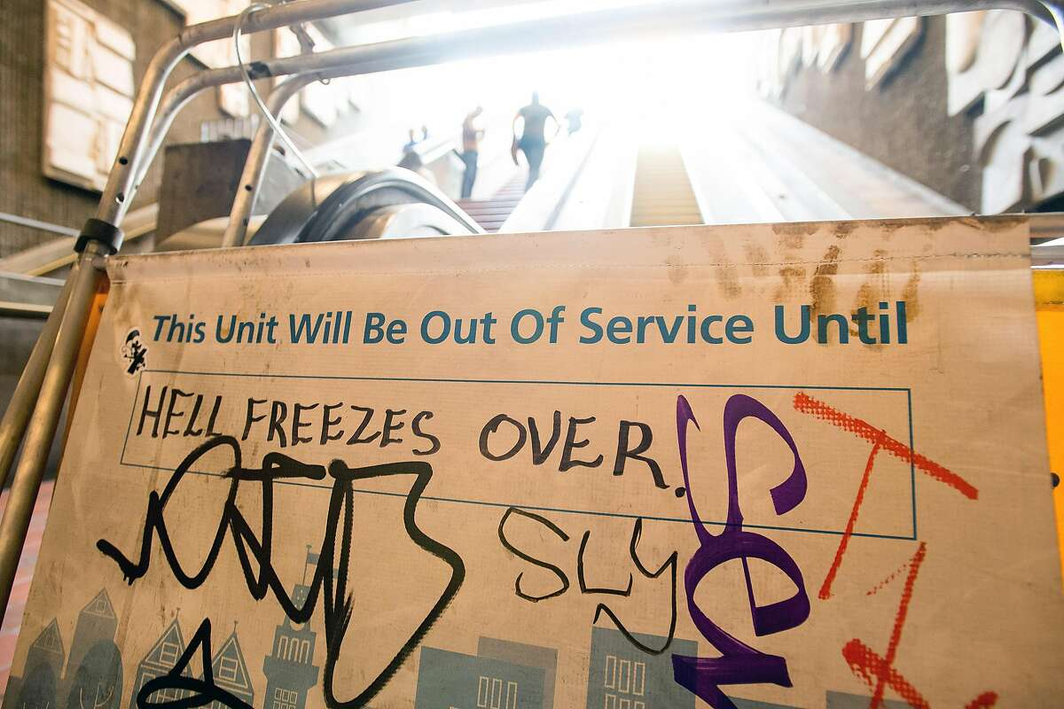 Graffiti covers a sign by an out of service escalator at BART's 24th Street Mission Station on Wednesday, May 24, 2017, in San Francisco.