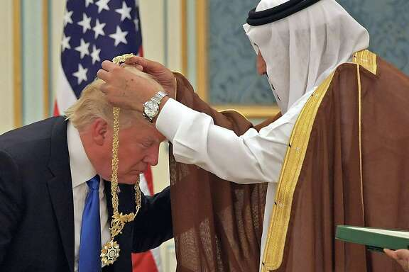 President Donald Trump receives a medal from Saudi Arabia's King Salman bin Abdulaziz al-Saud  at the Saudi Royal Court in Riyadh last week.