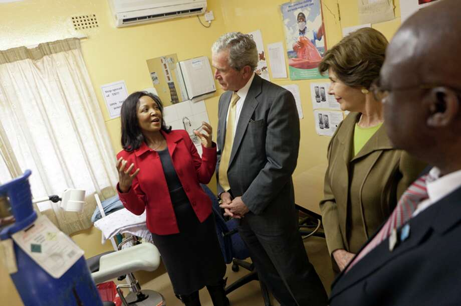 In this photo provided by the George W. Bush Presidential Center, Dr. Doreen Ramogola-Masire, Country Director, Botswana-UPenn Partnership Clinic, leads former President George W. Bush and Laura Bush on a tour of the Bontleng Clinic in Gaborone, Botswana, on Thursday, July 5, 2012.  The Bontleng Clinic offers screening for cervical cancer; which is the second most common cancer in Botswana and the leading cause of female related cancer deaths. The former president and his wife visited Africa for a week to promote a partnership between the George W. Bush Institute, the U.S. President's Emergency Plan for AIDS Relief, UNAIDS and Susan G. Komen for the Cure, that aims to fight cervical and breast cancer in sub-Saharan Africa. (AP Photo/George W. Bush Presidential Center, Shealah Craighead) Photo: Shealah Craighead, HONS / Stratford Booster Club