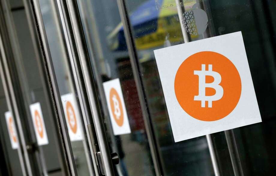 An agreement to upgrade the speed of processing transactions sent the digital currency bitcoin to a record high of $2,690 on Thursday.  Photo: Mark Lennihan, STF / Copyright 2016 The Associated Press. All rights reserved. This material may not be published, broadcast, rewritten or redistribu