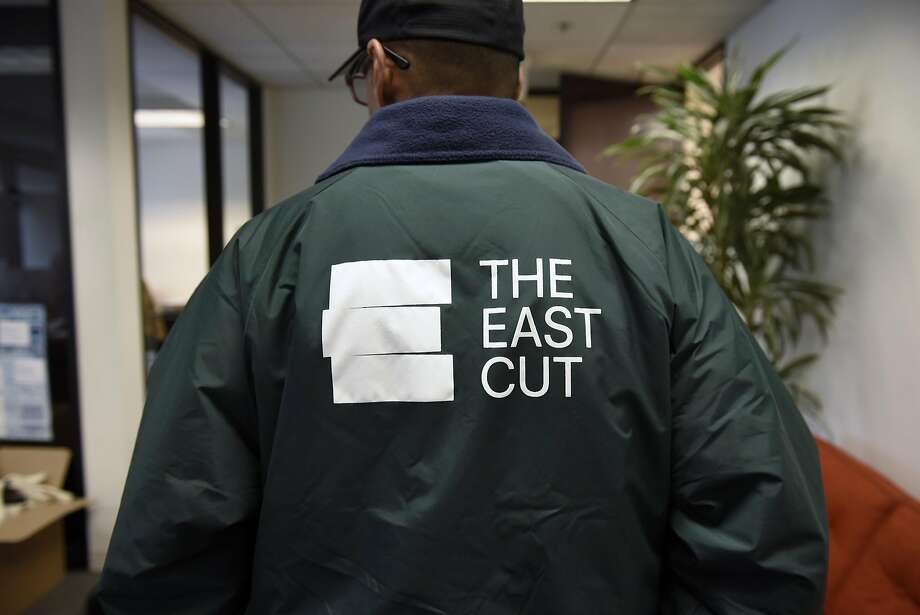 Mario Durado, community guide with the Rincon Hill Community Benefit District tries on a new East Cut jacket, in San Francisco, CA, on Thursday May 25, 2017. Photo: Michael Short, Special To The Chronicle