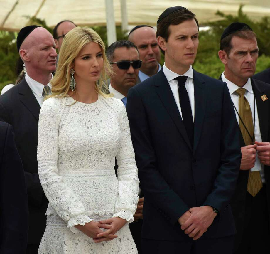 """Ivanka Trump and her husband Jared Kushner listen to U.S. President Donald Trump at the Yad Vashem Holocaust Museum in Jerusalem, Israel, Tuesday, May 23, 2017. President Donald Trump on Tuesday pushed for elusive peace between Israel and the Palestinians, calling on both sides to put aside the """"pain and disagreements of the past."""" (Debbie Hill, Pool via AP) Photo: Debbie Hill, POOL / Copyright 2017 The Associated Press. All rights reserved."""