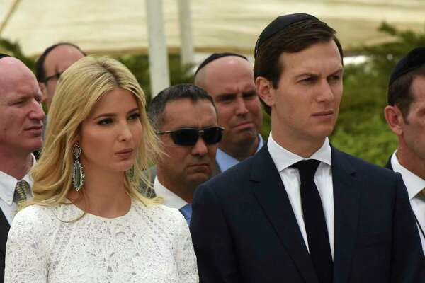 """Ivanka Trump and her husband Jared Kushner listen to U.S. President Donald Trump at the Yad Vashem Holocaust Museum in Jerusalem, Israel, Tuesday, May 23, 2017. President Donald Trump on Tuesday pushed for elusive peace between Israel and the Palestinians, calling on both sides to put aside the """"pain and disagreements of the past."""" (Debbie Hill, Pool via AP)"""