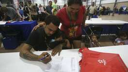 Christopher Hernandez fills out a job application with Ylora (cq) Posada Thursday May 25, 2017 during the Bexar County Second Chance Job Fair held at the Freeman Expo Hall. There were opportunities available in a variety of industries including hospitality, food service, construction, electrical, flooring, information, transportation, warehousing, assembly, automotive, telemarketing, and trucking. The fair featured businesses that are committed to hiring formally incarcerated local residents from all education and skill levels.