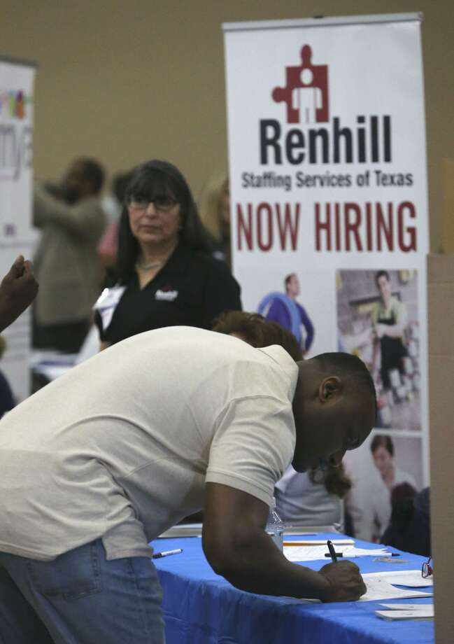 A job seeker fills out paper work during the Bexar County Second Chance Job Fair held at the Freeman Expo Hall. There were opportunities available in a variety of industries including hospitality, food service, construction, electrical, flooring, information, transportation, warehousing, assembly, automotive, telemarketing, and trucking. Photo: John Davenport /San Antonio Express-News / ©John Davenport/San Antonio Express-News