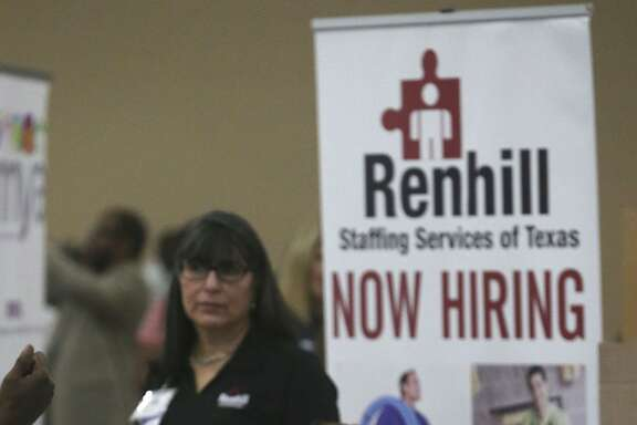 A job seeker fills out paper work during the Bexar County Second Chance Job Fair held at the Freeman Expo Hall. There were opportunities available in a variety of industries including hospitality, food service, construction, electrical, flooring, information, transportation, warehousing, assembly, automotive, telemarketing, and trucking.