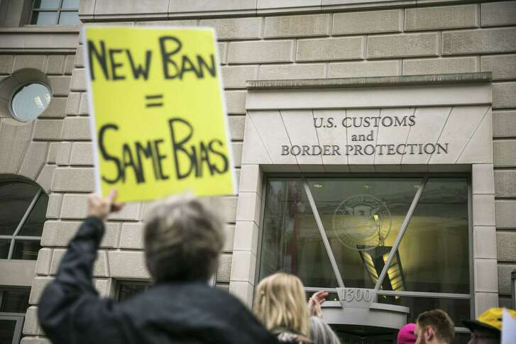 FILE -- Protesters demonstrate against President Donald TrumpÕs revised travel ban, outside the U.S. Customs and Border Protection headquarters in Washington, March 7, 2017. A federal appeals court in Richmond, Va. refused to reinstate the ban on May 25, saying it discriminated on the basis of religion; the case is likely to go to the Supreme Court. (Al Drago/The New York Times)