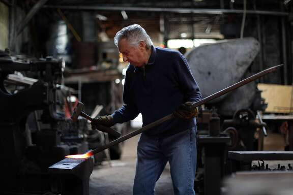 Tony Rosellini works on a pry bar at Edwin Klockar's Blacksmithing Shop in San Francisco, Calif., on Wednesday, May 24, 2017.  The shop is a piece of the last working bit of old Rincon Hill, a blacksmith shop on Folsom Street. It's a city landmark, with dirt floors in the back. But Tony Rosellini, the blacksmith is 87 years old, and its fate is in the air. Travis Kelly, his grandson, is rethinking the place.