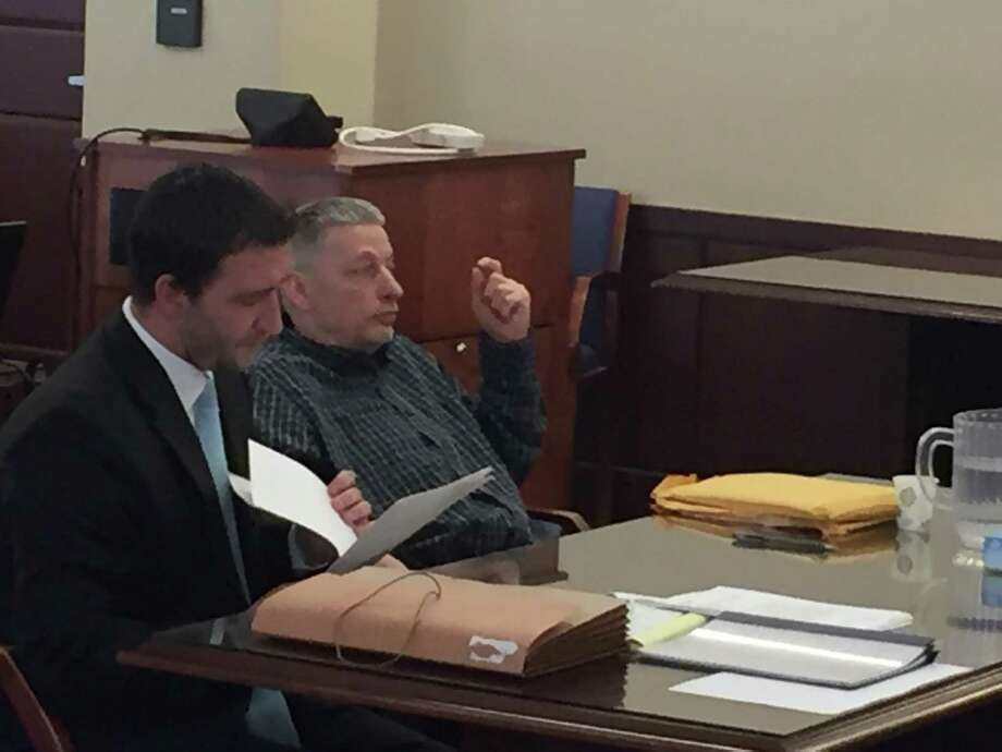 Dennis Boodrow, right, with his attorney, Kurt Haas, wait for the beginning of closing arguments at his grand larceny trial in Albany County Court. Boodrow has Huntington's disease, a lethal genetic ailment that destroys brain cells. (Robert Gavin / Times Union)