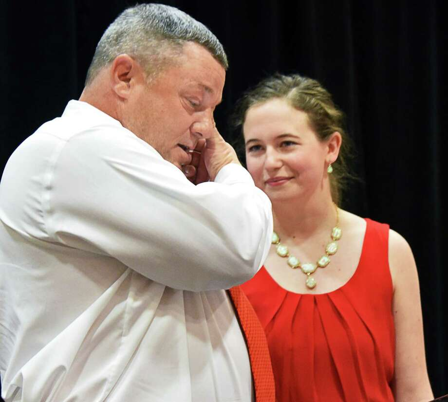 Steve Russell, left, who made the decision to donate his daughter, Klarissa Russell's organs after she died in a car crash, wipes away a tear as he and heart transplant recipient, Mayfield resident Anna King, 17, appear at the American Heart Association's Go Red for Women event Thursday May 25, 2017 in Colonie, NY.  (John Carl D'Annibale / Times Union) Photo: John Carl D'Annibale / 40040400A