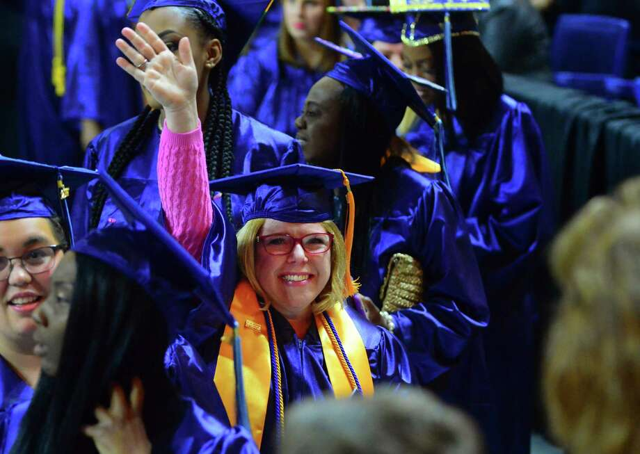 Joanne Elizabeth Gorlo, of Stratford, waves to her husband Brian and the rest of her family as she enters in the procession for Housatonic Community College's Commencement 2017 at the Webster Bank Arena in Bridgeport, Conn., on Thursday May 25, 2017. With 612 graduates, this is the college's 3rd largest graduating class in its history. Photo: Christian Abraham, Hearst Connecticut Media / Connecticut Post