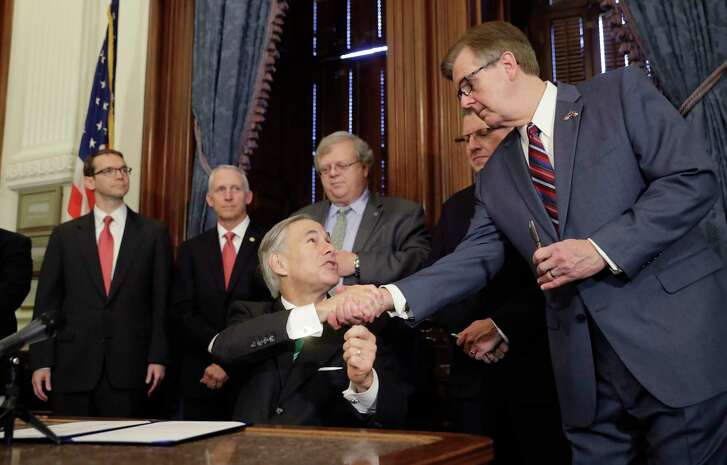 "Gov. Greg Abbott, center, signed SB 7, a bill to address inappropriate teacher-student relationships. ""Texas is going to impose real and stiff consequences on any teachers to have any inappropriate relationship,"" he said."