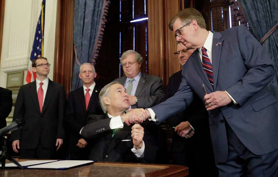 """Gov. Greg Abbott, center, signed SB 7, a bill to address inappropriate teacher-student relationships. """"Texas is going to impose real and stiff consequences on any teachers to have any inappropriate relationship,"""" he said.  Photo: Eric Gay, STF / Copyright 2017 The Associated Press. All rights reserved."""