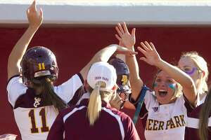 Deer Park players cheer after Erin Edmoundson, left, scored on Sara Vanderford's RBI double during the sixth inning in Game 1 of a Region III-5A final high school softball series at Cougar Softball Stadium, Thursday, May 25, 2017, in Houston. Deer Park defeated Katy 4-3 in 10 innings.