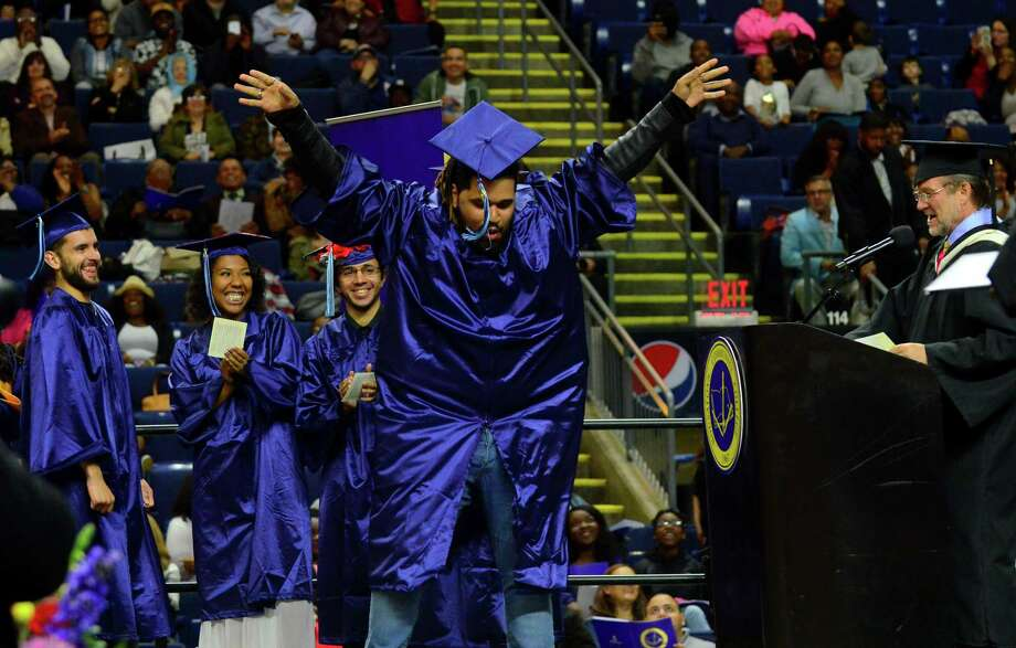 Graduate Eddie DeJesus-Diaz does a dance as he goes up for his diploma during Housatonic Community College's Commencement 2017 at the Webster Bank Arena in Bridgeport, Conn., on Thursday May 25, 2017. With 612 graduates, this is the college's 3rd largest graduating class in its history. Photo: Christian Abraham, Hearst Connecticut Media / Connecticut Post