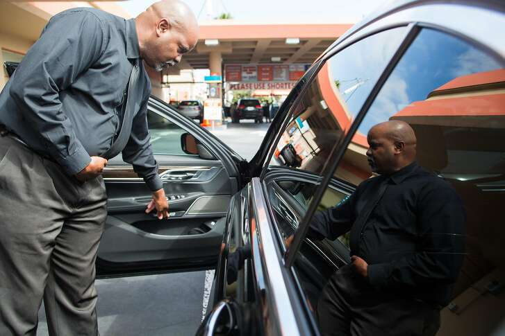 On May 25th, 2017, Ulandsey Peterson checks out his black BMW 740i after its car wash at LA Car Wash in Los Angeles, CA. As a luxury driver, Peterson says he makes sure his car looks its best for his clients and always chooses the most expensive car wash which includes a hand applied liquid wax.