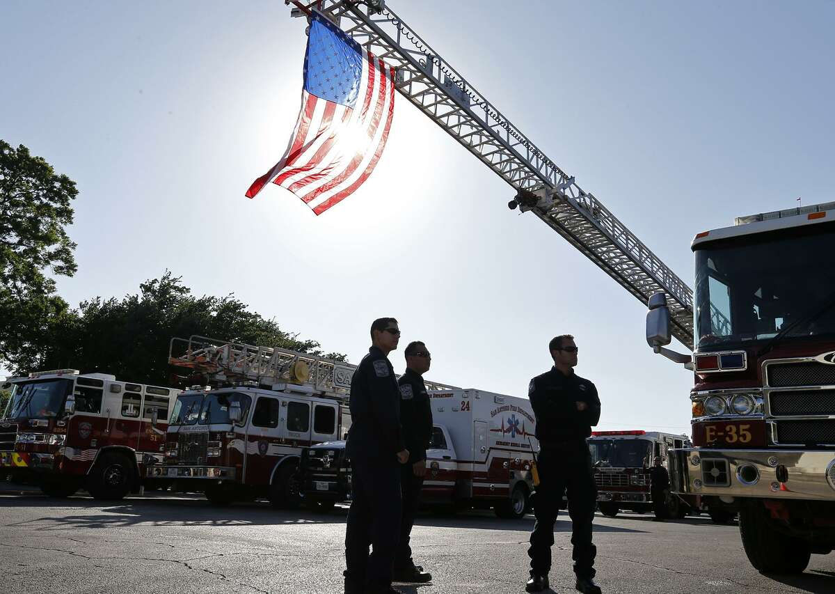 First responders stand outside Porter Loring Mortuary on May 25, 2017. Inside, mourners paid their respects to San Antonio Fire Department firefighter Scott Deem, who died May 18 while battling a blaze.