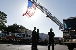 First responders stand outside Porter Loring Mortuary, 1101 McCullough Ave, for Thursday's public viewing of San Antonio Fire Department firefighter Scott Deem, who died last week while battling a fire at Ingram Square.